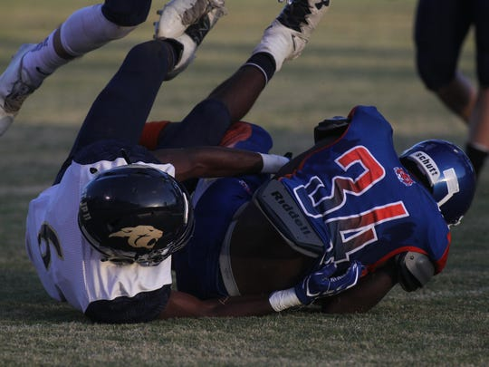 Jefferson County's Gekobe Smith recovers a fumble and is tackled by St. John Paul II's Will Evans.