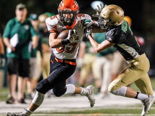 Union-Endicott's Jack Thomas gets pressure from Vestal's Adam Mieczkowski in the second quarter at Vestal's Dick Hoover Stadium on Friday, October 6, 2017. 