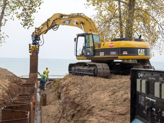 Construction crews work to install new jetties at Fort Gratiot Beach Oct. 6.