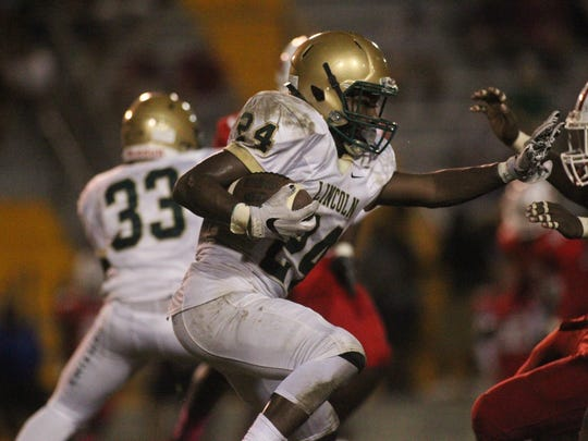 Lincoln running back Jalon Griffin breaks a run against Lincoln.