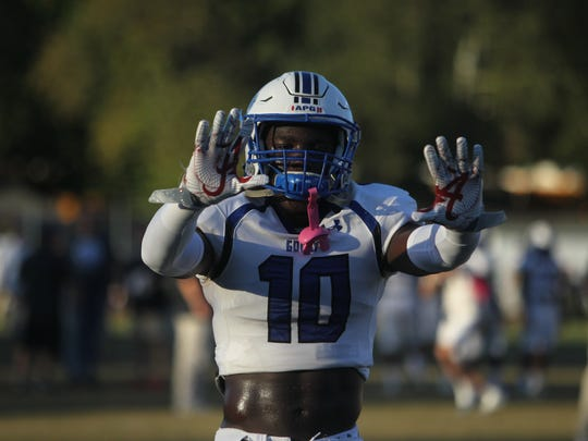 Godby safety Cortez Andrews gets hyped up before Friday night's game vs. Rickards.