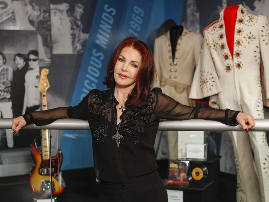 "Priscilla Presley stands in the ""60 years of Elvis"""