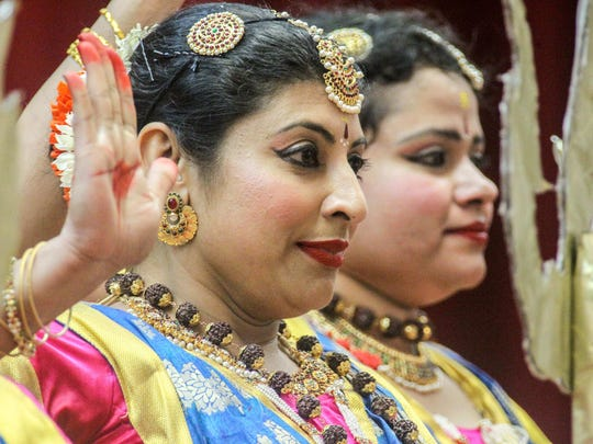 "Dancers performs during ancient Hindu festival called Diwali ""festival of lights"" Sunday, Oct 15, 2017 at the Nur Shrine in New Castle."