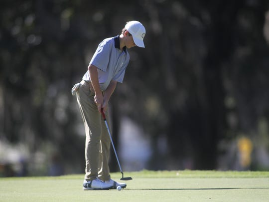 Maclay's Patrick McCann hits a putt on Southwood's hole No. 11.