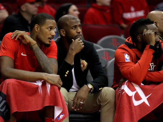 Houston Rockets guard Chris Paul (3) sits on the bench