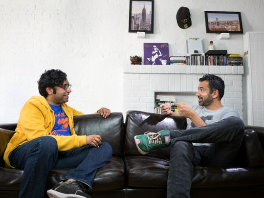 Comedian Hari Kondabolu, left, talks to actor Kal Penn