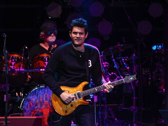 Singer-songwriter John Mayer performs on lead guitar with Dead & Company at Little Caesars Arena in Detroit.