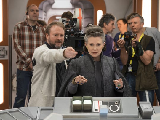Director Rian Johnson with Carrie Fisher on the set