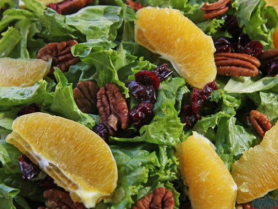 Mixed green salad with oranges, dried cranberries and