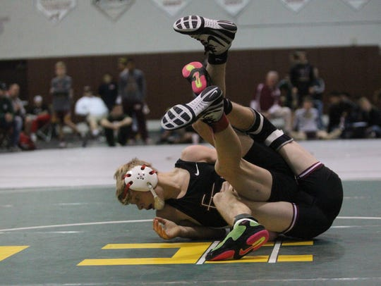 Florida High's Brooks Dyer wrestles during Saturday's