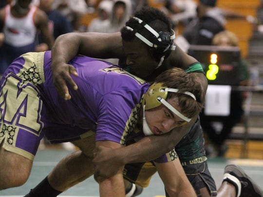 Lincoln's Selah Craft wrestles during Saturday's Capital City Classic at Chiles.
