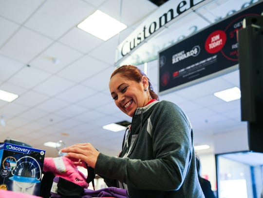 Jessica Vazquez rings up a customer Dec. 15 at JCPenney in the Sunset Mall. Vazquez relocated to San Angelo from Puerto Rico after Hurricane Maria.