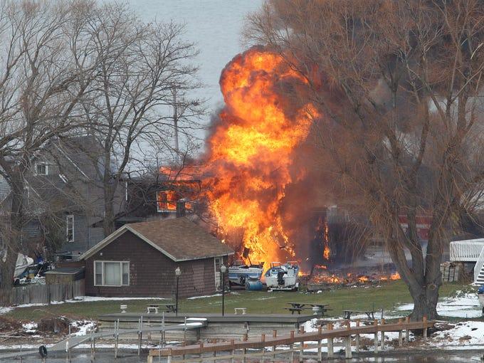 A house burns Monday December 24, 2012, in Webster.after