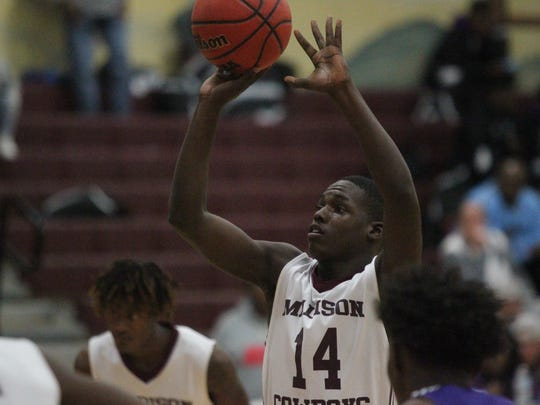 Madison County's Demarvion Brown shoots a free throw during a 72-36 win over Crossroad Academy on Tuesday.