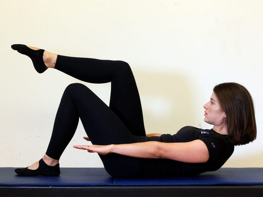 Erin Stern the advanced position for the Pilates exercise, leg lift supine.