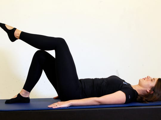 Erin Stern the ending position for the Pilates exercise, leg lift supine.