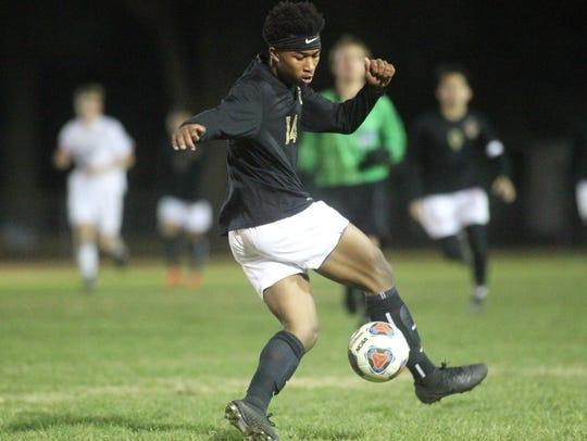 Florida High's Burnic Jordan plays a ball.