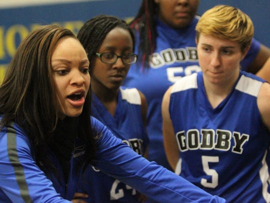 Godby coach Chelsea Johnson talks to her team during