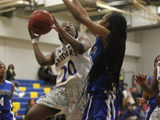 Rickards' Kalen Blathers goes up for a contested layup in a game against Godby.