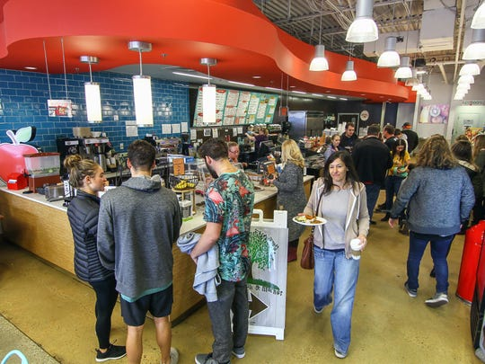 Customers wait in line to purchase their food during the inaugural Funky Funday Vegan Brunch Sunday, Jan. 21, 2018, at Newark Natural Foods in Newark, DE