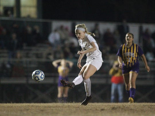 Maddie Powell and the Leon Lions girls soccer team