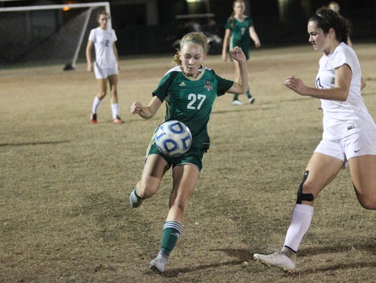 Lincoln's Lexi Gray plays a ball as Leon defeated Lincoln