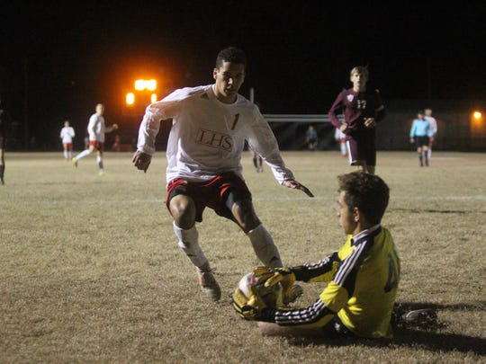 Chiles keeper Abe Darwish makes a sliding stop to reach Leon's through ball pass before Sy Fontenot gets there.