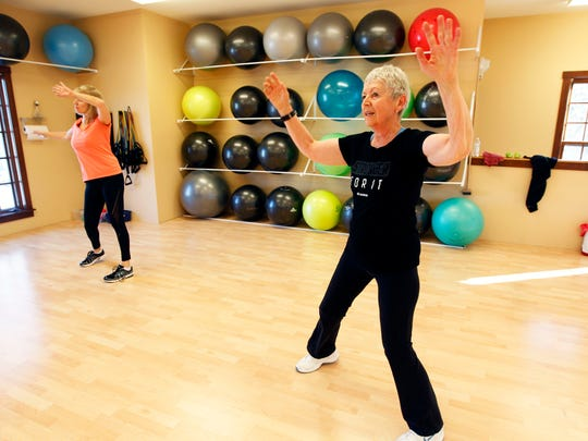 Marilyn Short takes part in the Dance Mixx  Jazzercise class in Delafield last month.