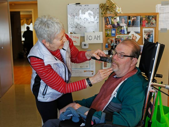 Marilyn Short, shaves her husband, Tom, at Lake Country