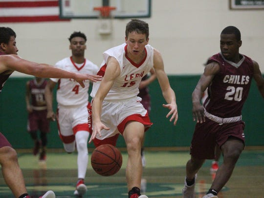 Leon's Mitchell Guse dribbles up the court on a fastbreak