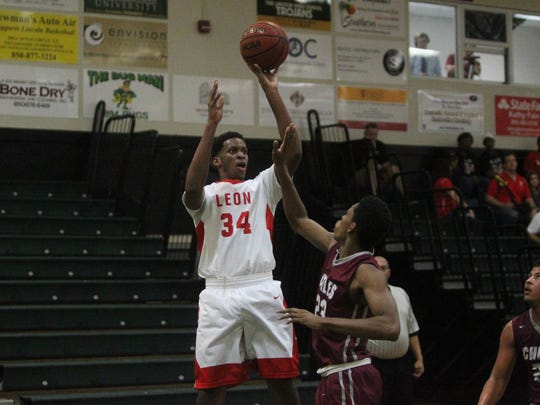 Leon's Jakari Gallon takes a jumper during a district