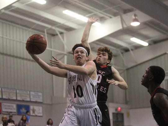 St. John Paul II's Brian Woodend goes up for a layup