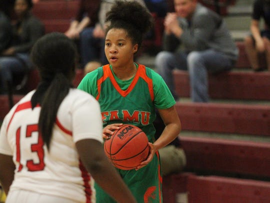 LaKrista Walker and FAMU DRS beat NFC 50-49 in a Region