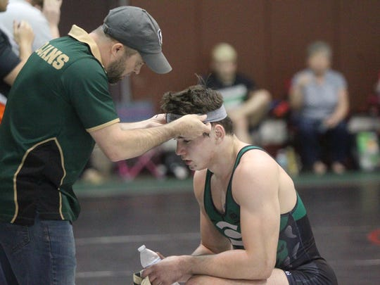 Lincoln's Justin Grant is knighted by Trojans coach
