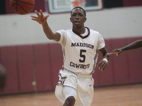 Madison County's Ken Hawkins makes a pass to the corner during a Region 3-1A final win against Hawthorne.
