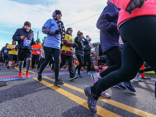 Thousands of people take off from the starting line