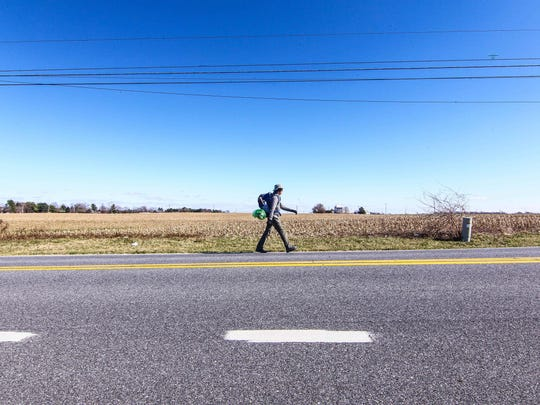Gilbert Hernandez walks down Old State Road in Odessa Sunday during a six-day walk from Northern Delaware to Southern Delaware.  Delaware is the fifth state he's walked, and he wants to walk all 50 before he's 50.