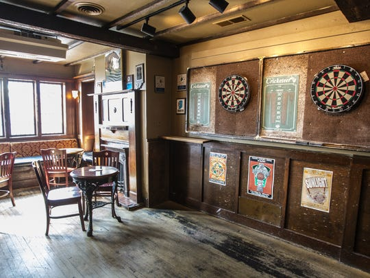 Corner Wine Bar's distinctive spaces include darts at The Wellington pub, better known as The Welly. Open since 1982, Corner Wine Bar in Broad Ripple will be sold, remodeled and renamed in March 2018.
