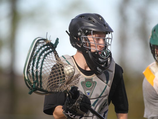 Lincoln's lacrosse team practices on its home field,