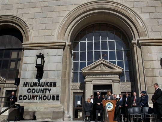 Milwaukee Corporation Counsel Margaret Daun is joined by other Milwaukee County officials outside the courthouse Wednesday to announce federal lawsuit against pharmaceutical drug makers and distributors suspected of contributing to the local opioid epidemic.