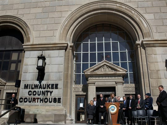 Milwaukee Corporation Counsel Margaret Daun is joined by other Milwaukee County officials outside the courthouse Wednesday to announce a federal lawsuit against pharmaceutical drug makers and distributors suspected of contributing to the local opioid epidemic.
