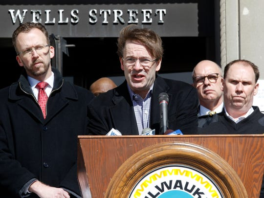 Milwaukee County Executive Chris Abele speaks Wednesday at a courthouse news conference announcing a federal lawsuit against pharmaceutical drug companies and distributors suspected of contributing to the local opioid epidemic. Abele was joined by Milwaukee County Board Chairman Theodore Lipscomb Sr. (left) and Milwaukee County Undersheriff Tobie Weberg (right).