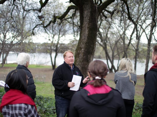 Terry Hanson, center, a Redding project manager, speaks to members of the Community Services Advisory Commission and other city officials Wednesday during a tour of some of the city's parks.