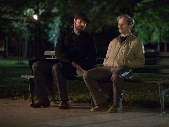 Oleg (Costa Ronin), left, here meeting with a disguised Philip (Matthew Rhys), is paying for his decision to leave the Soviet Union to take on a clandestine mission in the U.S.