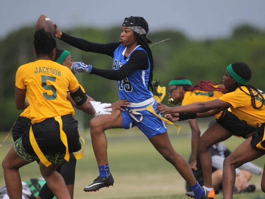 Godby's Gisele Jones stretches for a touchdown as Miami