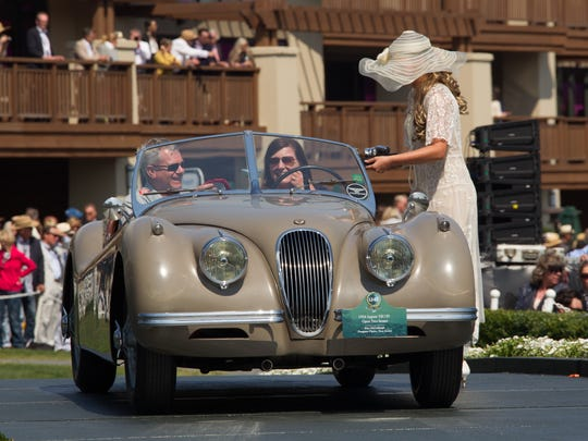 Mitch and Kim McCullough receive award at the 2017 Pebble Beach Concours d'Elegance for their 1954 Jaguar XK120, which earned second place in the Post War Preservation Class.