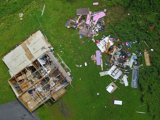 A house destroyed by hurricane winds is seen in Barranquitas,
