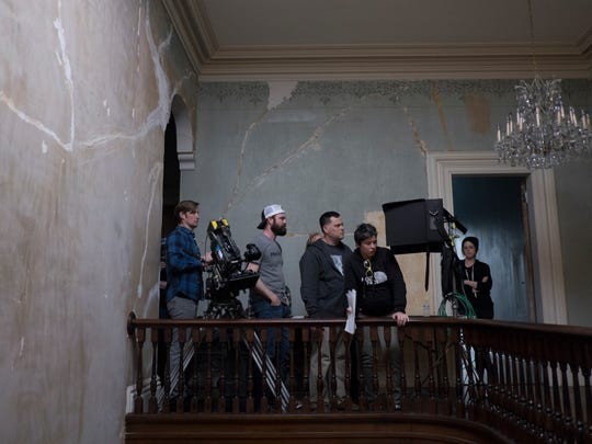 "Abetted by a who's who of Memphis film talent, director Mark Jones (third from left) shoots ""Winding Brook"" at Annesdale Mansion."