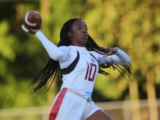 Florida High's Jada Rhodes throws a pass against Lincoln.