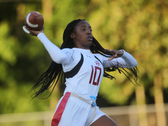 Florida High's Jada Rhodes throws a pass against Lincoln.